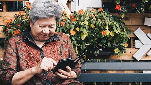 Senior woman using her mobile smart phone to look up information