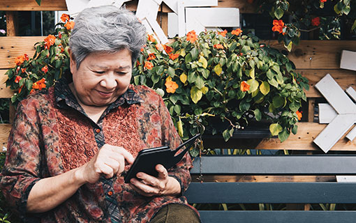 Senior woman engages with her smart phone