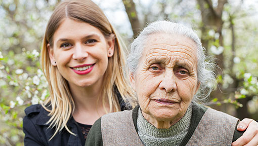 Senior mother living with dementia and her professional daughter in her mid 30s