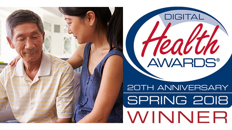 Middle aged woman gently comforts her father living with dementia - 2018 Digital Health Award Winner