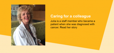 Head shot image of smiling staff member on yellow background. Text reads Caring for a Colleague. Julia is a staff member who became a patient when she was diagnosed with cancer. Read her story
