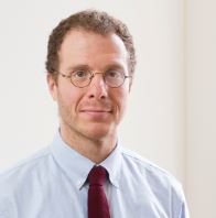Headshot of Dr. Aaron Orkin