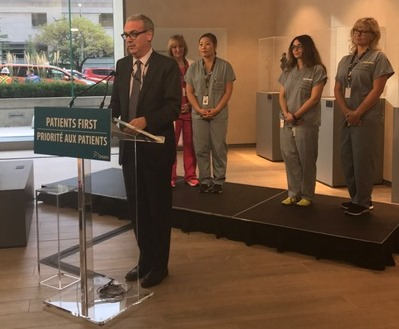 Dr. Gary Newton speaking at news conference