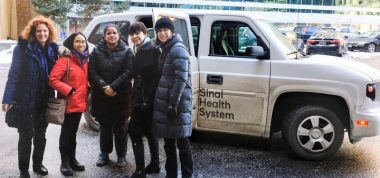 Colleagues in front of a van