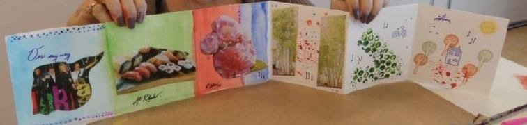 Close up view of a visual arts project created by a patient at Bridgepoint. The work is a fold out booklet with different panels, each with a different painting, drawing or image on it.