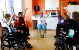 Photo shows a group of staff members and patients participated in creative movement exercise