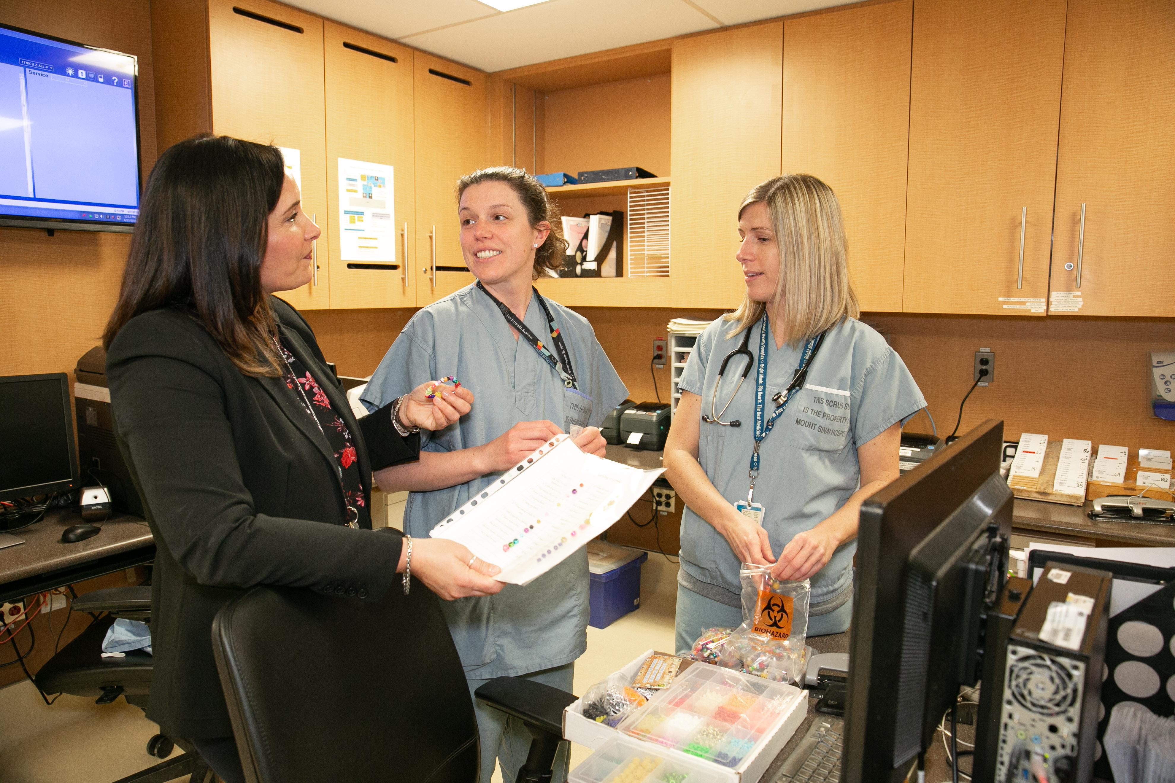 Three nurses on a unit interacting