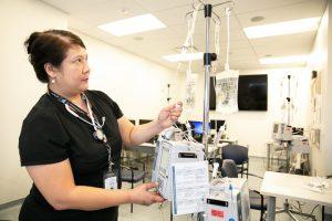 Nurse using smart pump IV pump