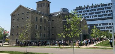 Image of Bridgepoint building with a lineup of people waiting to visit during Doors Open Toronto