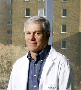 Headshot of Dr. Allan Detsky wearing white labcoat
