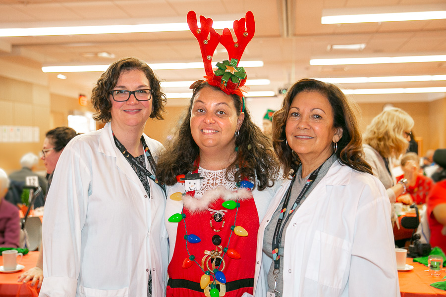 Two of the organizers of this year's holiday meal from Food Services with one of the staff members who helped serve