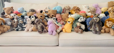 Fisher Baby with Stuffed animals donation