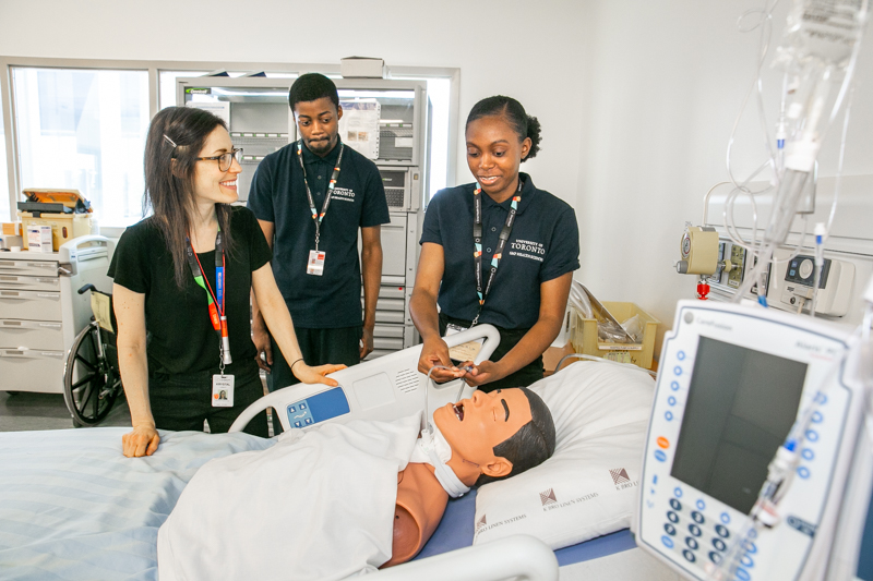 At Bridgepoint, Joel and Leah visited the learning lab used for training and practicing clinical skills. Here, Krystal, Interim Manager, Professional Practice, Nursing, shows how nurses practice suctioning a breathing tube (tracheostomy).