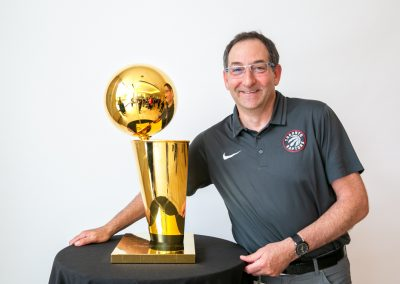 Employees with Larry O'Brien NBA Championship Trophy