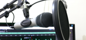 image of a computer and a microphone
