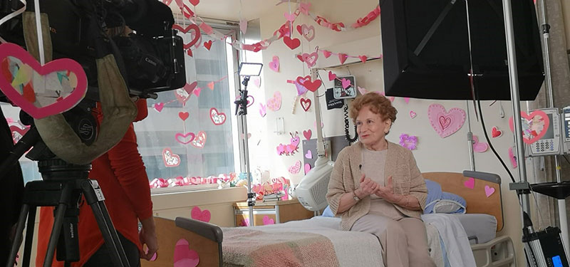 Image of room decorated with hearts, and patient on a bed