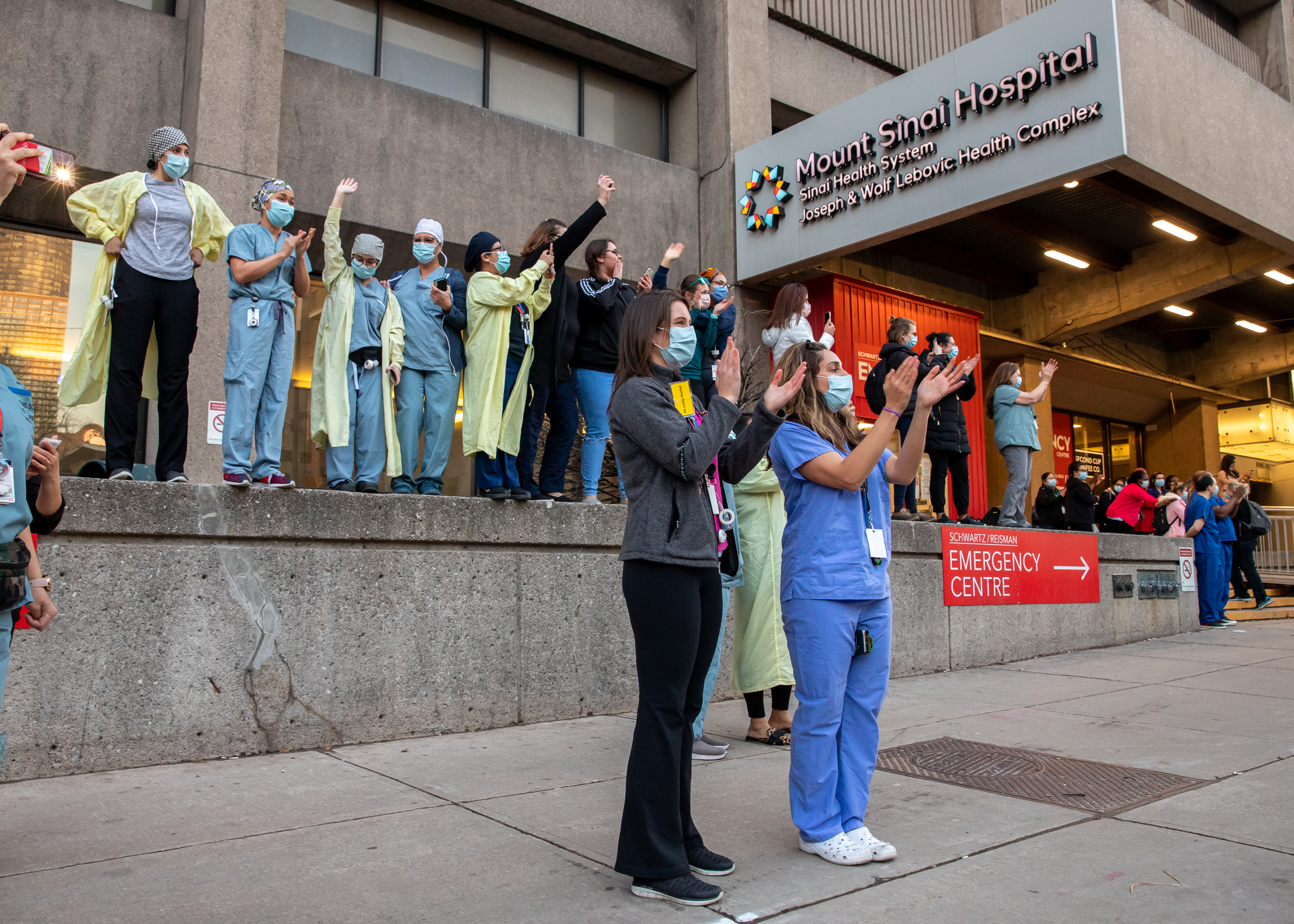 Health care workers clapping for TPS parade