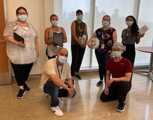 Hospital employees wearing medical masks looking at the camera