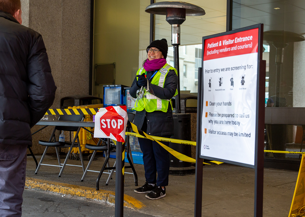 Screener at the patient and visitor entrance