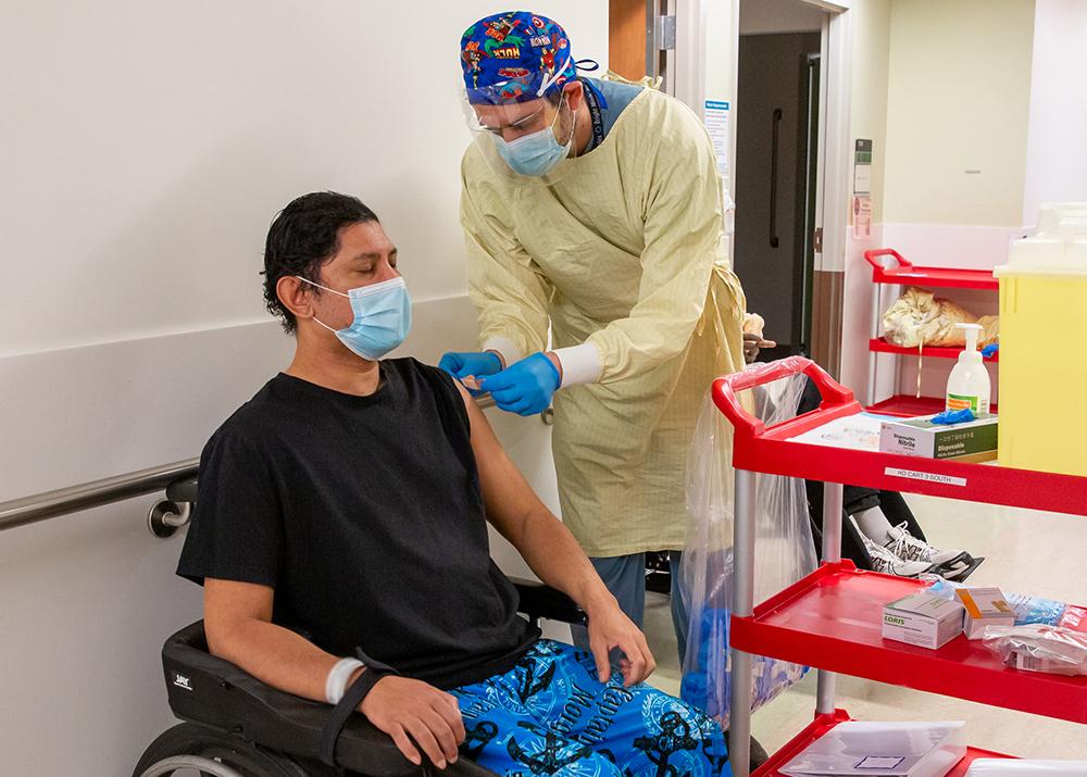 Sinai Health vaccine squad administering vaccine at bridgepoint