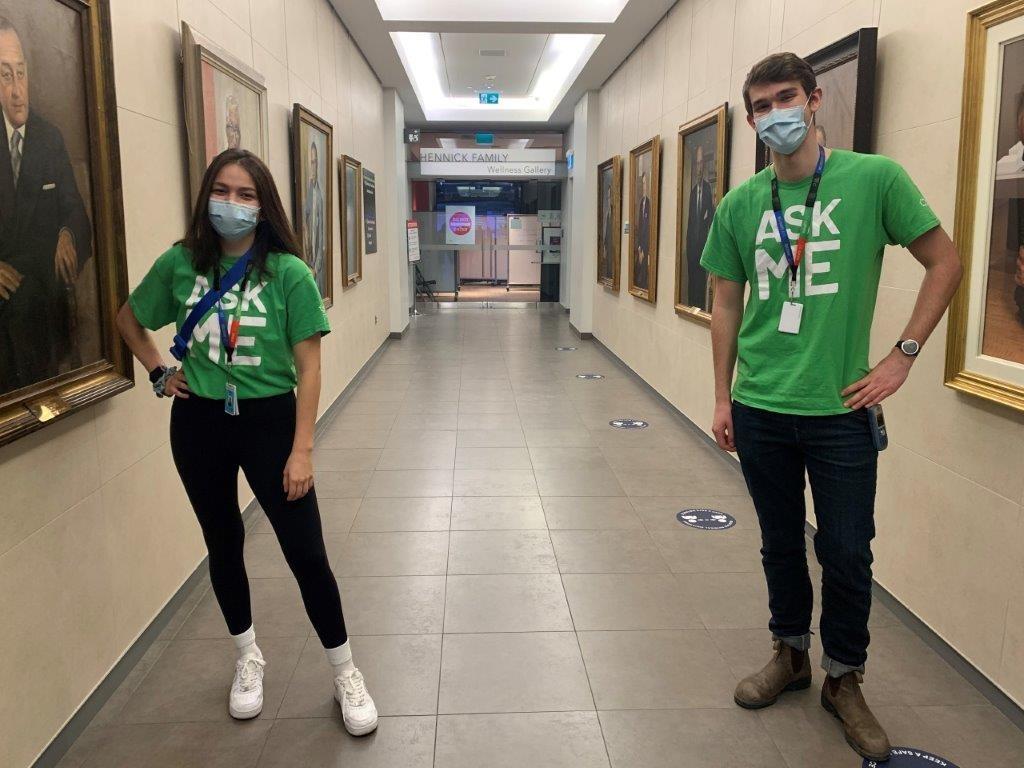 Photo of Nicole Cevallos and Matthew Cormie, AskMe volunteers