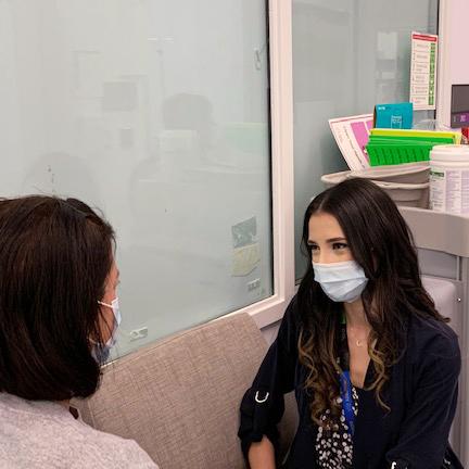 Yolanda speaks to a patient